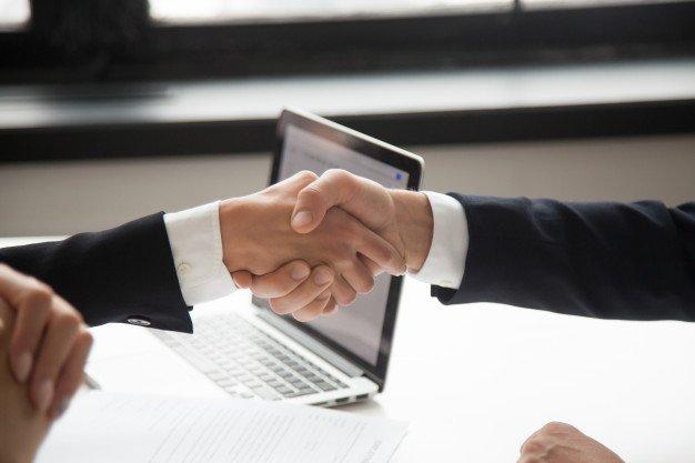 businessman-handshaking-businesswoman-showing